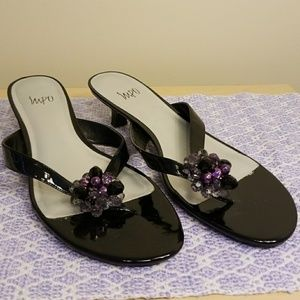 Cute sandals with beaded accent.